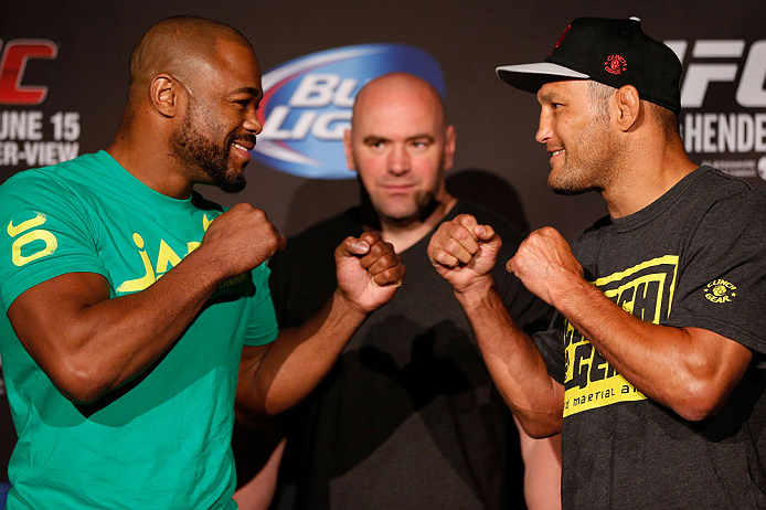 WINNIPEG, CANADA - JUNE 13:  (L-R) Opponents Rashad Evans and Dan Henderson face off during the UFC 161 media day at The Met on June 13, 2013 in Winnipeg, Manitoba, Canada.  (Photo by Josh Hedges/Zuffa LLC/Zuffa LLC via Getty Images)