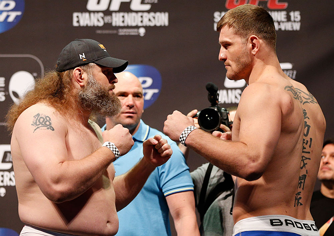 "WINNIPEG, CANADA - JUNE 14:  (L-R) Opponents ""Big Country"" Roy Nelson and Stipe Miocic face off during the UFC 161 weigh-in at the MTS Centre on June 14, 2013 in Winnipeg, Manitoba, Canada.  (Photo by Josh Hedges/Zuffa LLC/Zuffa LLC via Getty Images)"