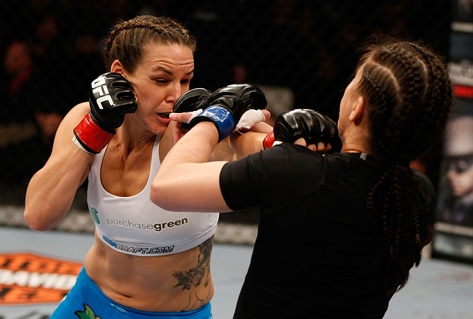 WINNIPEG, CANADA - JUNE 15:  (L-R) Alexis Davis punches Rosi Sexton in their bantamweight fight during the UFC 161 event at the MTS Centre on June 15, 2013 in Winnipeg, Manitoba, Canada.  (Photo by Josh Hedges/Zuffa LLC/Zuffa LLC via Getty Images)