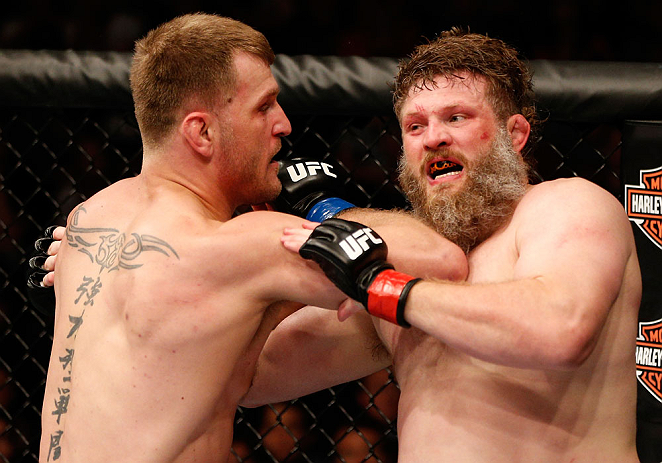 "WINNIPEG, CANADA - JUNE 15:  (L-R) Stipe Miocic elbows ""Big Country"" Roy Nelson in their heavyweight fight during the UFC 161 event at the MTS Centre on June 15, 2013 in Winnipeg, Manitoba, Canada.  (Photo by Josh Hedges/Zuffa LLC/Zuffa LLC via Getty Images)"