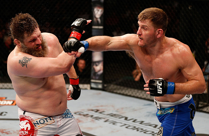 "WINNIPEG, CANADA - JUNE 15:  (R-L) Stipe Miocic punches ""Big Country"" Roy Nelson in their heavyweight fight during the UFC 161 event at the MTS Centre on June 15, 2013 in Winnipeg, Manitoba, Canada.  (Photo by Josh Hedges/Zuffa LLC/Zuffa LLC via Getty Images)"