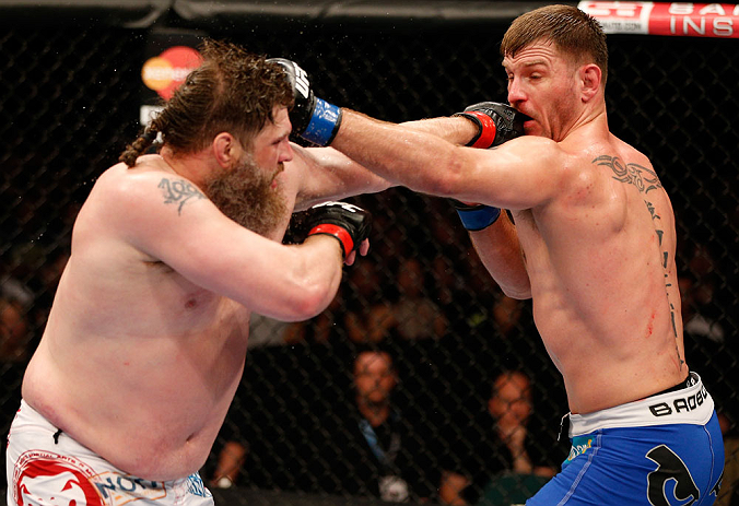 "WINNIPEG, CANADA - JUNE 15:  (L-R) ""Big Country"" Roy Nelson and Stipe Miocic trade punches in their heavyweight fight during the UFC 161 event at the MTS Centre on June 15, 2013 in Winnipeg, Manitoba, Canada.  (Photo by Josh Hedges/Zuffa LLC/Zuffa LLC via Getty Images)"