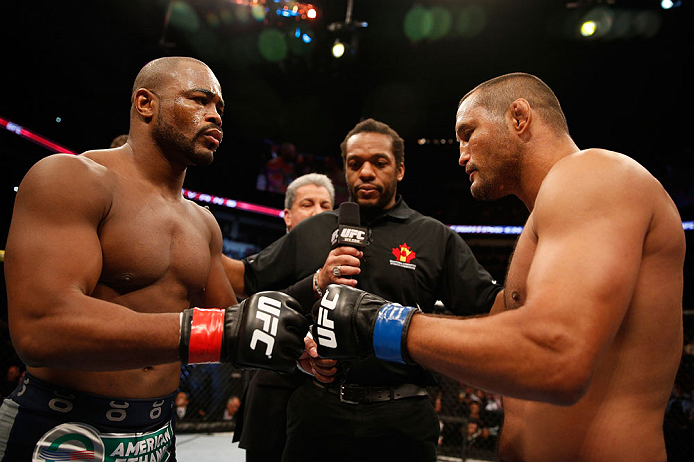 WINNIPEG, CANADA - JUNE 15:  (L-R) Opponents Rashad Evans and Dan Henderson touch gloves before their light heavyweight fight during the UFC 161 event at the MTS Centre on June 15, 2013 in Winnipeg, Manitoba, Canada.  (Photo by Josh Hedges/Zuffa LLC/Zuffa LLC via Getty Images)