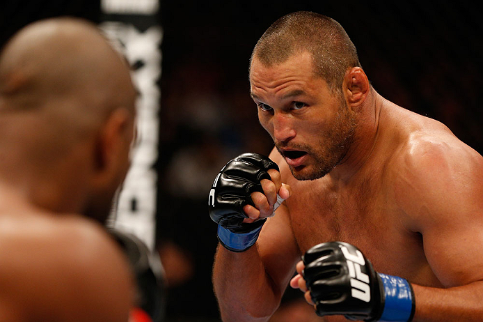 WINNIPEG, CANADA - JUNE 15:  (R-L) Dan Henderson squares off with Rashad Evans in their light heavyweight fight during the UFC 161 event at the MTS Centre on June 15, 2013 in Winnipeg, Manitoba, Canada.  (Photo by Josh Hedges/Zuffa LLC/Zuffa LLC via Getty Images)