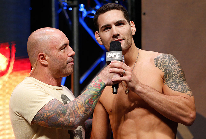 LAS VEGAS, NV - JULY 05:  (R-L) Chris Weidman is interviewed by Joe Rogan after weighing in during the UFC 162 weigh-in at the Mandalay Bay Events Center on July 5, 2013 in Las Vegas, Nevada.  (Photo by Josh Hedges/Zuffa LLC/Zuffa LLC via Getty Images)