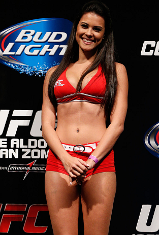 RIO DE JANEIRO, BRAZIL - AUGUST 02:  UFC Octagon Girl Camila Rodrigues de Oliveira stands on stage during the UFC 163 weigh-in at HSBC Arena on August 2, 2013 in Rio de Janeiro, Brazil. (Photo by Josh Hedges/Zuffa LLC/Zuffa LLC via Getty Images)