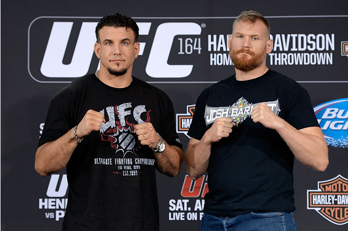 MILWAUKEE, WI - AUGUST 29:  (L-R) Frank Mir and Josh Barnett pose for photos during a UFC press conference at the BMO Harris Bradley Center on August 29, 2013 in Milwaukee, Wisconsin. (Photo by Jeff Bottari/Zuffa LLC/Zuffa LLC via Getty Images)
