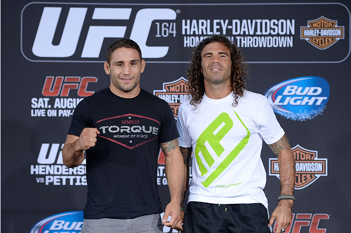 MILWAUKEE, WI - AUGUST 29:  (L-R) Chad Mendes and Clay Guida pose for photos during a UFC press conference at the BMO Harris Bradley Center on August 29, 2013 in Milwaukee, Wisconsin. (Photo by Jeff Bottari/Zuffa LLC/Zuffa LLC via Getty Images)