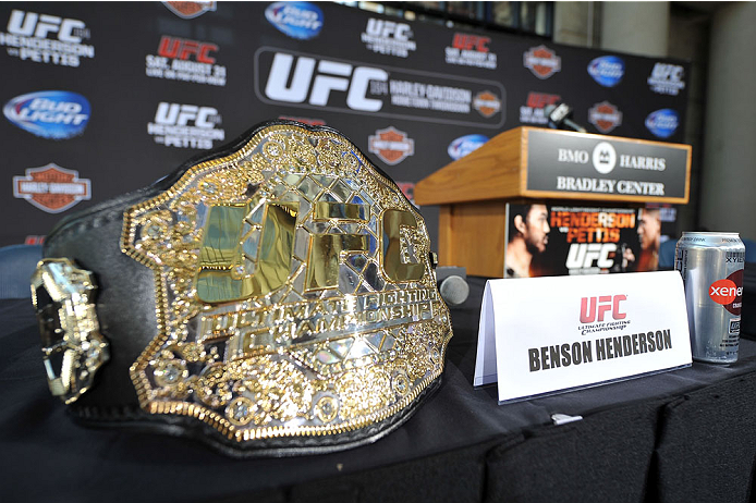 MILWAUKEE, WI - AUGUST 29:  The UFC Lightweight Championship belt belonging to Benson 'Smooth' Henderson (not pictured) rests onstage during a UFC press conference at the BMO Harris Bradley Center on August 29, 2013 in Milwaukee, Wisconsin. (Photo by Jeff Bottari/Zuffa LLC/Zuffa LLC via Getty Images)