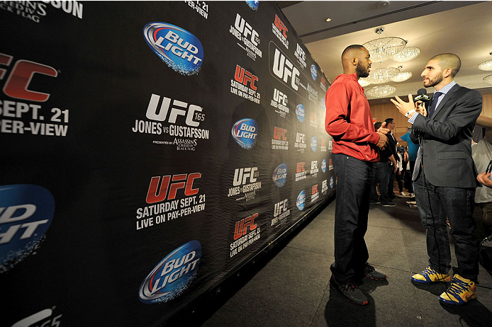 TORONTO, CANADA - SEPTEMBER 19:  UFC light heavyweight champion Jon 'Bones' Jones (L) speaks with MMA journalist Ariel Helwani (R) during the UFC 165 Ultimate Media Day at the Shangri-La Hotel on September 19, 2013 in Toronto, Ontario, Canada. (Photo by Jeff Bottari/Zuffa LLC/Zuffa LLC via Getty Images) *** Local Caption *** Jon Jones; Ariel Helwani