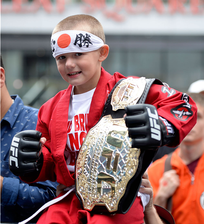 TORONTO, CANADA - SEPTEMBER 20:  A young fan poses for a photo during the Q&A session before the UFC 165 weigh-in at the Maple Leaf Square on September 20, 2013 in Toronto, Ontario, Canada. (Photo by Jeff Bottari/Zuffa LLC/Zuffa LLC via Getty Images)