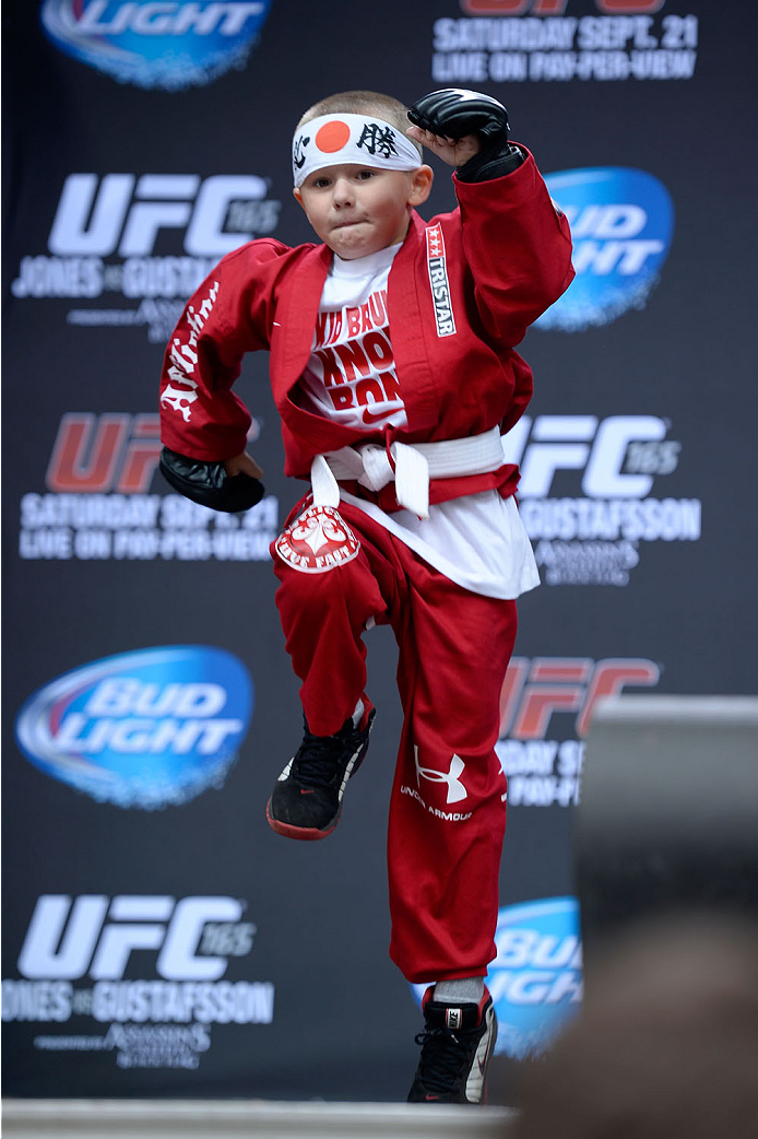 TORONTO, CANADA - SEPTEMBER 20:  A young fan shows his mms skills to the crowd during a Q&A session before the UFC 165 weigh-in at the Maple Leaf Square on September 20, 2013 in Toronto, Ontario, Canada. (Photo by Jeff Bottari/Zuffa LLC/Zuffa LLC via Getty Images)