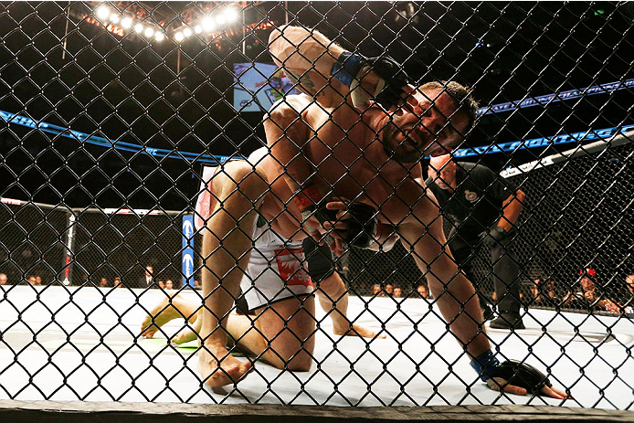 TORONTO, CANADA - SEPTEMBER 21:  Daniel Omielanczuk (white shorts) leans against the cage while fighting Nandor Guelmino in their UFC heavyweight bout at the Air Canada Center on September 21, 2013 in Toronto, Ontario, Canada. (Photo by Josh Hedges/Zuffa LLC/Zuffa LLC via Getty Images) *** Local Caption *** Nandor Guelmino; Daniel Omielanczuk