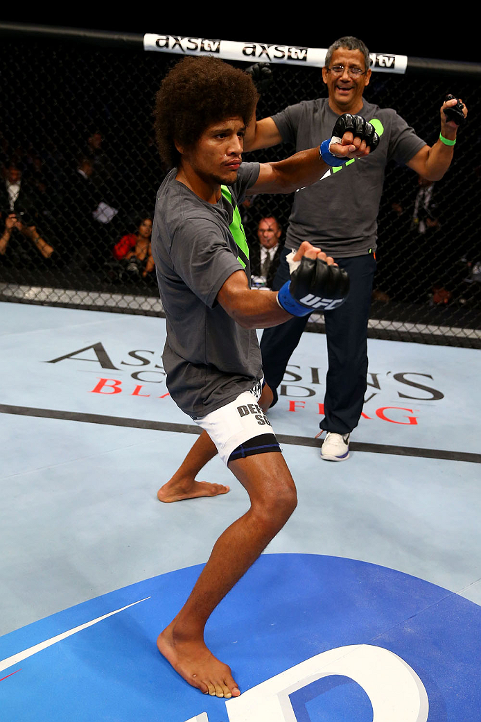 TORONTO, CANADA - SEPTEMBER 21:  Alex Caceres celebrates after defeating Roland Delorme (not pictured) in their UFC bantamweight bout at the Air Canada Center on September 21, 2013 in Toronto, Ontario, Canada. (Photo by Al Bello/Zuffa LLC/Zuffa LLC via Getty Images) *** Local Caption *** Alex Caceres