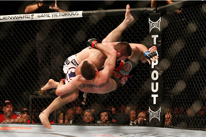 TORONTO, CANADA - SEPTEMBER 21:  (L-R) Khabib Nurmagomedov takes down Pat Healy in their UFC lightweight bout at the Air Canada Center on September 21, 2013 in Toronto, Ontario, Canada. (Photo by Josh Hedges/Zuffa LLC/Zuffa LLC via Getty Images) *** Local Caption *** Pat Healy; Khabib Nurmagomedov
