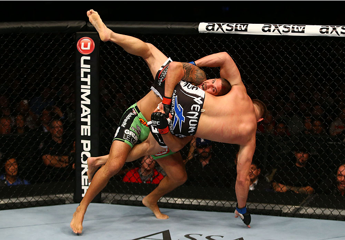 TORONTO, CANADA - SEPTEMBER 21:  (L-R) Brendan Schaub takes down Matt Mitrione in their UFC heavyweight bout at the Air Canada Center on September 21, 2013 in Toronto, Ontario, Canada. (Photo by Al Bello/Zuffa LLC/Zuffa LLC via Getty Images) *** Local Caption *** Brendan Schaub; Matt Mitrione