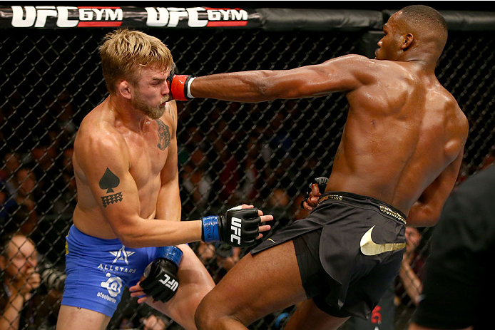 Jon 'Bones' Jones punches Alexander 'The Mauler' Gustafsson in their UFC light heavyweight championship bout at the Air Canada Center on September 21, 2013 in Toronto, ON, Canada. (Photo by Josh Hedges/Zuffa LLC)