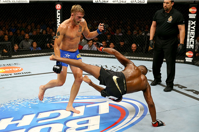TORONTO, CANADA - SEPTEMBER 21:  Alexander Gustafsson trips up Jon 'Bones' Jones in their UFC light heavyweight championship bout at the Air Canada Center on September 21, 2013 in Toronto, Ontario, Canada. (Photo by Al Bello/Zuffa LLC/Zuffa LLC via Getty Images) *** Local Caption *** Jon Jones; Alexander Gustafsson