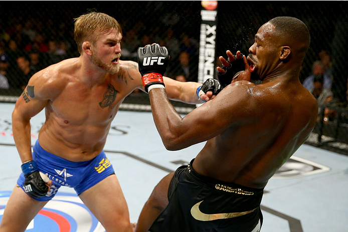 TORONTO, CANADA - SEPTEMBER 21:  (L-R) Alexander Gustafsson punches Jon 'Bones' Jones in their UFC light heavyweight championship bout at the Air Canada Center on September 21, 2013 in Toronto, Ontario, Canada. (Photo by Al Bello/Zuffa LLC/Zuffa LLC via Getty Images) *** Local Caption *** Jon Jones; Alexander Gustafsson