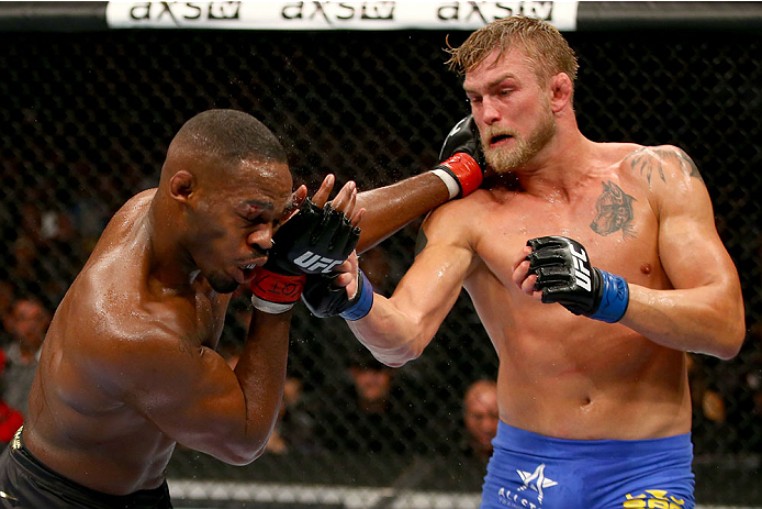 TORONTO, CANADA - SEPTEMBER 21:  (R-L) Alexander Gustafsson punches Jon 'Bones' Jones in their UFC light heavyweight championship bout at the Air Canada Center on September 21, 2013 in Toronto, Ontario, Canada. (Photo by Al Bello/Zuffa LLC/Zuffa LLC via Getty Images) *** Local Caption *** Jon Jones; Alexander Gustafsson
