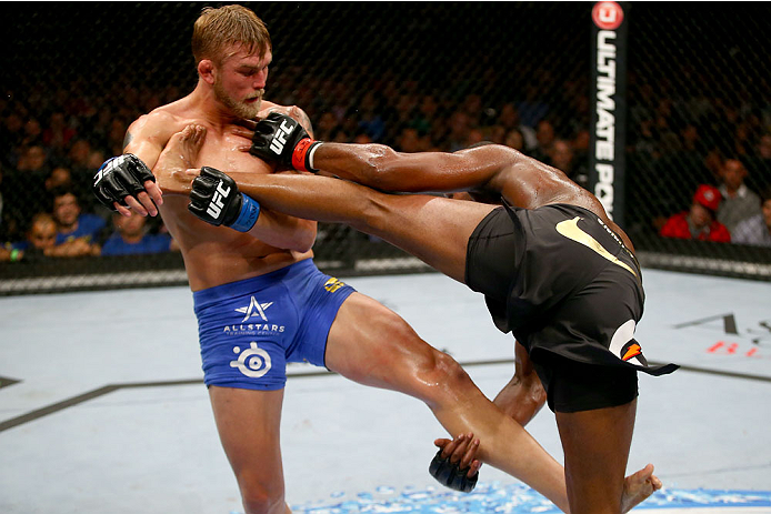 TORONTO, CANADA - SEPTEMBER 21:  (L-R) Alexander Gustafsson grabs the leg of Jon 'Bones' Jones in their UFC light heavyweight championship bout at the Air Canada Center on September 21, 2013 in Toronto, Ontario, Canada. (Photo by Al Bello/Zuffa LLC/Zuffa LLC via Getty Images) *** Local Caption *** Jon Jones; Alexander Gustafsson