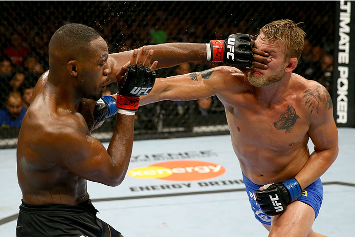 TORONTO, CANADA - SEPTEMBER 21:  (L-R) Jon 'Bones' Jones punches Alexander Gustafsson in their UFC light heavyweight championship bout at the Air Canada Center on September 21, 2013 in Toronto, Ontario, Canada. (Photo by Al Bello/Zuffa LLC/Zuffa LLC via Getty Images) *** Local Caption *** Jon Jones; Alexander Gustafsson