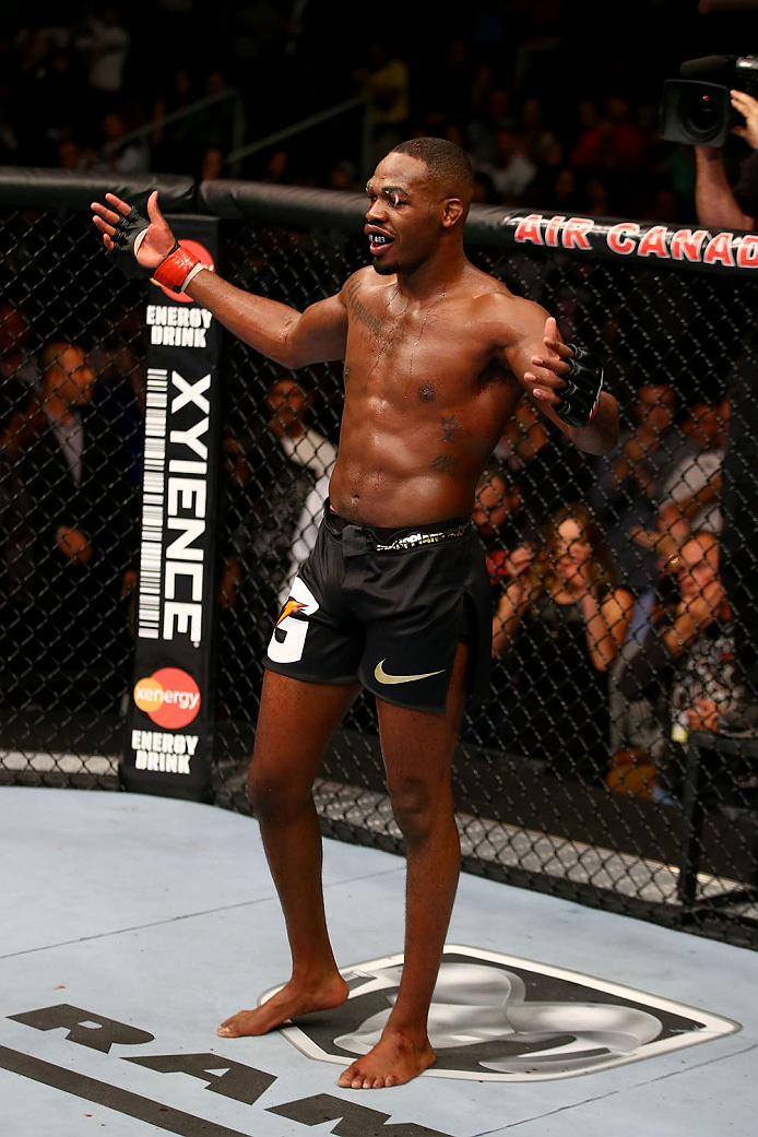 TORONTO, CANADA - SEPTEMBER 21:  Jon 'Bones' Jones gestures to the crowd during his fight against Alexander Gustafsson (not pictured) in their UFC light heavyweight championship bout at the Air Canada Center on September 21, 2013 in Toronto, Ontario, Canada. (Photo by Al Bello/Zuffa LLC/Zuffa LLC via Getty Images) *** Local Caption *** Jon Jones