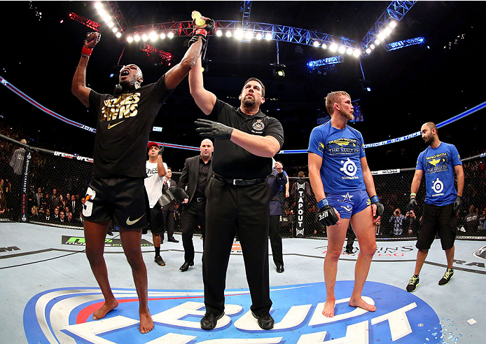TORONTO, CANADA - SEPTEMBER 21:  Jon 'Bones' Jones (L) celebrates after defeating Alexander Gustafsson (R) in their UFC light heavyweight championship bout at the Air Canada Center on September 21, 2013 in Toronto, Ontario, Canada. (Photo by Al Bello/Zuffa LLC/Zuffa LLC via Getty Images) *** Local Caption *** Jon Jones; Alexander Gustafsson