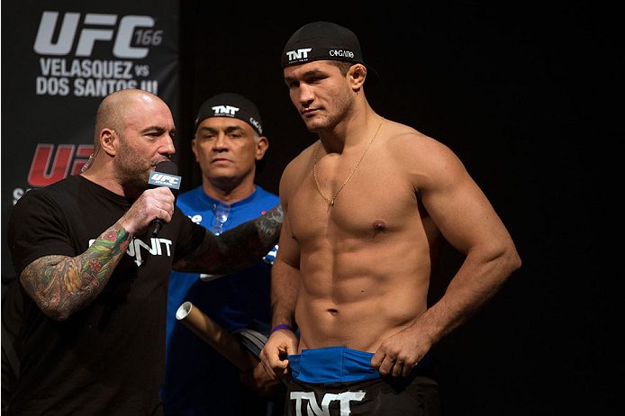 HOUSTON, TX - OCTOBER 18:  Junior Dos Santos (R) talks with Joe Rogan (L) on stage during the UFC 166 weigh-in at the Toyota Center on October 18, 2013 in Houston, Texas. (Photo by Jeff Bottari/Zuffa LLC/Zuffa LLC via Getty Images) *** Local Caption *** Junior Dos Santos; Joe Rogan