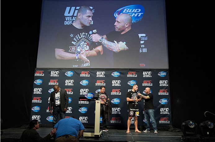 HOUSTON, TX - OCTOBER 18:  UFC heavyweight champion Cain Velasquez (L) talks with Joe Rogan (R) on stage during the UFC 166 weigh-in at the Toyota Center on October 18, 2013 in Houston, Texas. (Photo by Jeff Bottari/Zuffa LLC/Zuffa LLC via Getty Images) *** Local Caption *** Cain Velasquez; Joe Rogan