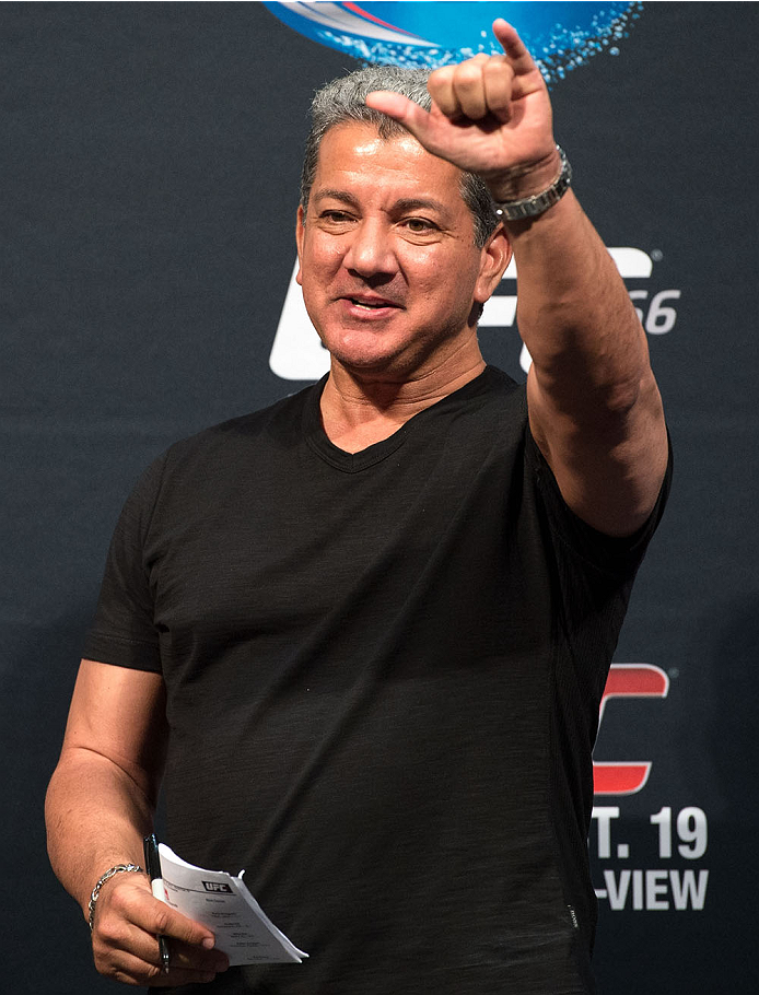 HOUSTON, TX - OCTOBER 18:  UFC Octagon announcer Bruce Buffer waves to the fans during the UFC 166 weigh-in at the Toyota Center on October 18, 2013 in Houston, Texas. (Photo by Jeff Bottari/Zuffa LLC/Zuffa LLC via Getty Images) *** Local Caption *** Bruce Buffer