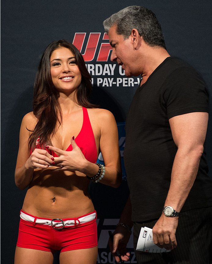 HOUSTON, TX - OCTOBER 18:  UFC Octagon Girl Arianny Celeste talks with UFC Octagon announcer Bruce Buffer on stage during the UFC 166 weigh-in at the Toyota Center on October 18, 2013 in Houston, Texas. (Photo by Jeff Bottari/Zuffa LLC/Zuffa LLC via Getty Images) *** Local Caption *** Arianny Celeste; Bruce Buffer