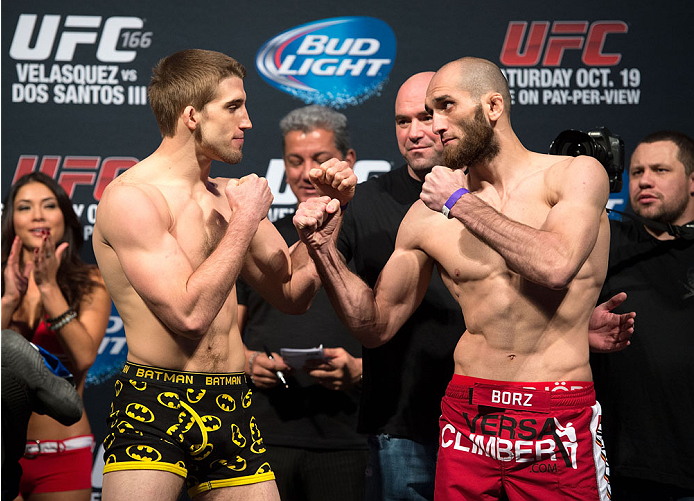 HOUSTON, TX - OCTOBER 18:  (L-R) TJ Waldburger and Adlan Amagov face off during the UFC 166 weigh-in at the Toyota Center on October 18, 2013 in Houston, Texas. (Photo by Jeff Bottari/Zuffa LLC/Zuffa LLC via Getty Images) *** Local Caption *** TJ Waldburger; Adlan Amagov