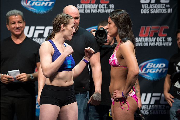 HOUSTON, TX - OCTOBER 18:  (L-R) Sarah Kaufman and Jessica Eye face off during the UFC 166 weigh-in at the Toyota Center on October 18, 2013 in Houston, Texas. (Photo by Jeff Bottari/Zuffa LLC/Zuffa LLC via Getty Images) *** Local Caption *** Sarah Kaufman; Jessica Eye