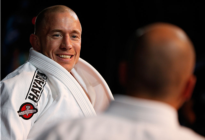 LAS VEGAS, NV - NOVEMBER 13: (L-R) UFC welterweight champion Georges St-Pierre trains with UFC legend Royce Gracie during an open workout session for media inside the Hollywood Theatre at the MGM Grand Hotel/Casino on November 13, 2013 in Las Vegas, Nevada. (Photo by Josh Hedges/Zuffa LLC/Zuffa LLC via Getty Images)
