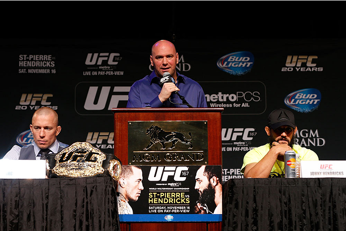 LAS VEGAS, NV - NOVEMBER 14: UFC President Dana White (center) hosts the final UFC 167 pre-fight press conference with UFC welterweight champion Georges St-Pierre (L) and challenger Johny Hendricks (R) inside the Hollywood Theatre at the MGM Grand Hotel/Casino on November 14, 2013 in Las Vegas, Nevada. (Photo by Josh Hedges/Zuffa LLC/Zuffa LLC via Getty Images)
