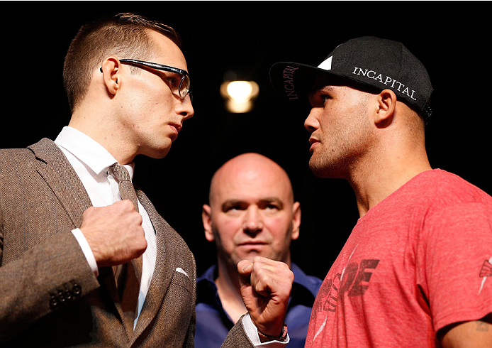 LAS VEGAS, NV - NOVEMBER 14: (L-R) Opponents Rory MacDonald and Robbie Lawler face off during the final UFC 167 pre-fight press conference inside the Hollywood Theatre at the MGM Grand Hotel/Casino on November 14, 2013 in Las Vegas, Nevada. (Photo by Josh Hedges/Zuffa LLC/Zuffa LLC via Getty Images)