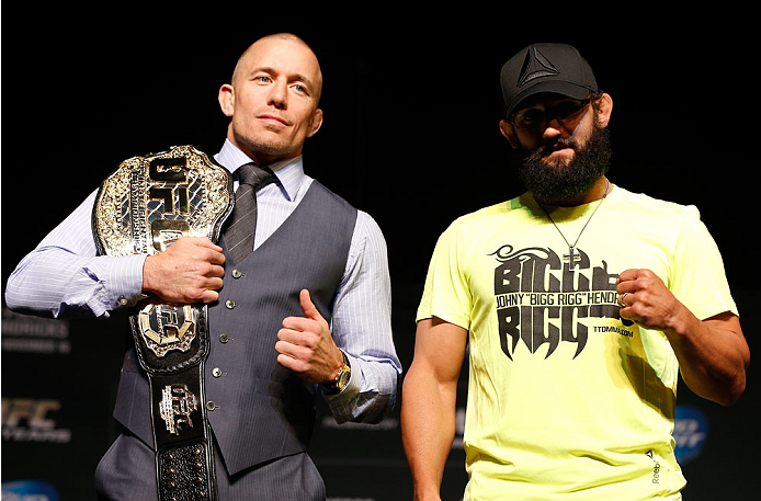 LAS VEGAS, NV - NOVEMBER 14: (L-R) Opponents Georges St-Pierre and Johny Hendricks pose for photos during the final UFC 167 pre-fight press conference inside the Hollywood Theatre at the MGM Grand Hotel/Casino on November 14, 2013 in Las Vegas, Nevada. (Photo by Josh Hedges/Zuffa LLC/Zuffa LLC via Getty Images)