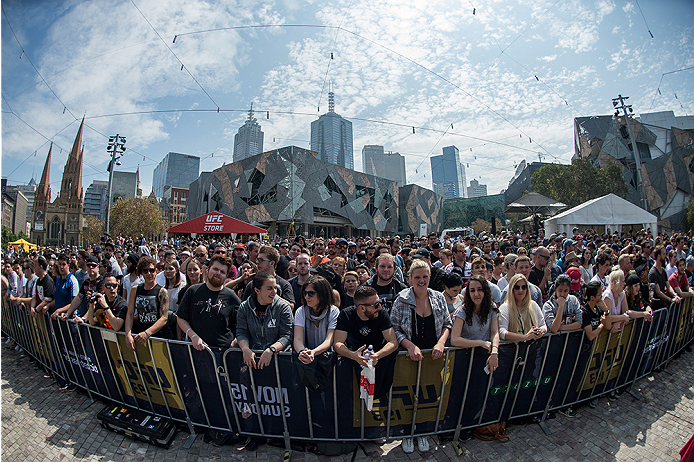 MELBOURNE, AUSTRALIA - NOVEMBER 12:  Fans watch as UFC women's bantamweight champion Ronda Rousey of the United States holds an open workout for fans and media at Federation Square on November 12, 2015 in Melbourne, Australia. (Photo by Brandon Magnus/Zuffa LLC/Zuffa LLC via Getty Images)