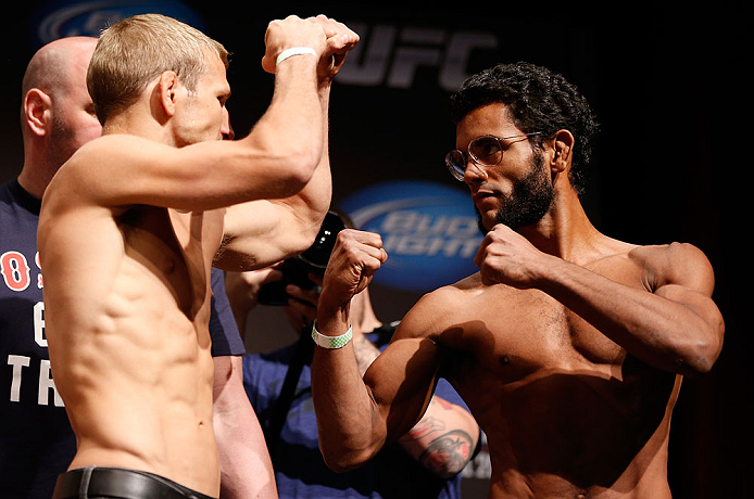 "SAN JOSE, CA - APRIL 19:   (L-R) Opponents T.J. Dillashaw and Hugo ""Wolverine"" Viana face off during the UFC on FOX weigh-in at the California Theatre on April 19, 2013 in San Jose, California.  (Photo by Josh Hedges/Zuffa LLC/Zuffa LLC via Getty Images)"