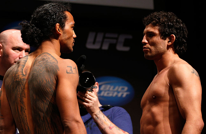 SAN JOSE, CA - APRIL 19:   (L-R) Opponents Benson Henderson and Gilbert Melendez face off during the UFC on FOX weigh-in at the California Theatre on April 19, 2013 in San Jose, California.  (Photo by Josh Hedges/Zuffa LLC/Zuffa LLC via Getty Images)