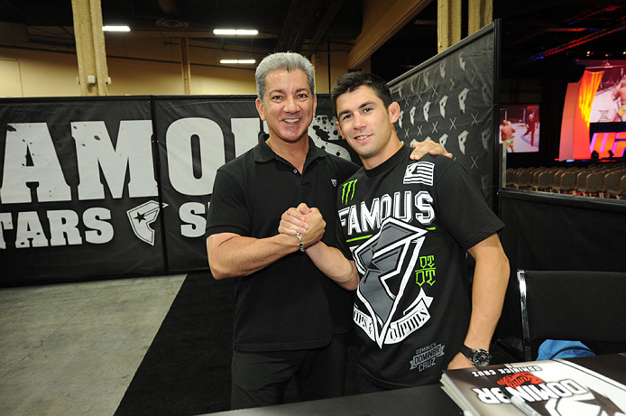 LAS VEGAS, NV - JULY 06:  Dominick Cruz and Bruce Buffer in attendance at the UFC Fan Expo on July 6, 2012 in Las Vegas, Nevada. (Photo by Al Powers /Zuffa LLC/Zuffa LLC via Getty Images)