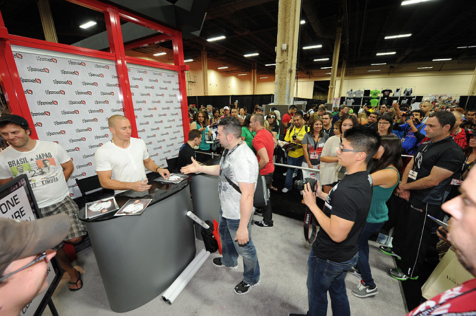 LAS VEGAS, NV - JULY 06:  UFC welterweight champion Georges St-Pierre meets fans at the UFC Fan Expo on July 6, 2012 in Las Vegas, Nevada. (Photo by Al Powers /Zuffa LLC/Zuffa LLC via Getty Images)