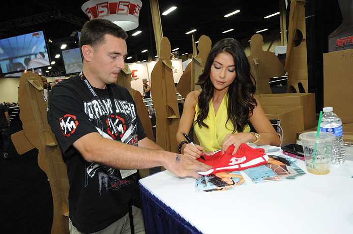 LAS VEGAS, NV - JULY 7:  Arianny Celeste signs autographs for fans during the UFC Fan Expo at the Mandalay Bay Convention Center on July 7, 2012 in Las Vegas, Nevada.  (Photo by Al Powers/Zuffa LLC/Zuffa LLC via Getty Images)  *** Local Caption ***
