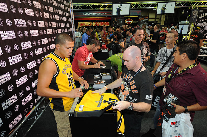 LAS VEGAS, NV - JULY 7:   Anthony Pettis and Sam Stout sign autographs during the UFC Fan Expo at the Mandalay Bay Convention Center on July 7, 2012 in Las Vegas, Nevada.  (Photo by Al Powers/Zuffa LLC/Zuffa LLC via Getty Images)  *** Local Caption ***