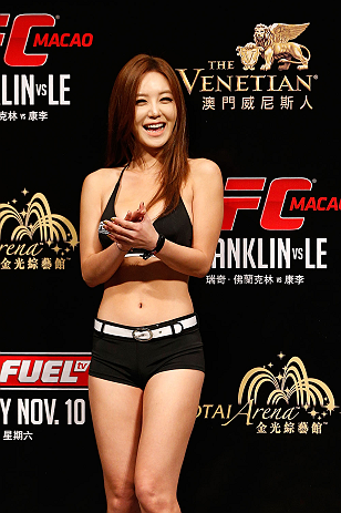 MACAU, MACAU - NOVEMBER 09:  UFC Octagon Girl Ye-Bin Kang stands on stage during the UFC Macau weigh in at Cotai Arena on November 9, 2012 in Macau, Macau.  (Photo by Josh Hedges/Zuffa LLC/Zuffa LLC via Getty Images)