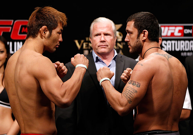 MACAU, MACAU - NOVEMBER 09:  (L-R) Opponents Riki Fukuda and Tom DeBlass face off during the UFC Macau weigh in at Cotai Arena on November 9, 2012 in Macau, Macau.  (Photo by Josh Hedges/Zuffa LLC/Zuffa LLC via Getty Images)