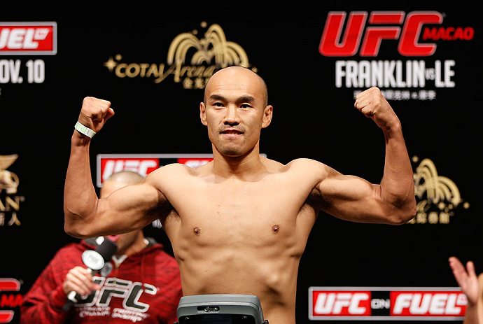 MACAU, MACAU - NOVEMBER 09:  Tiequan Zhang makes weight during the UFC Macau weigh in at Cotai Arena on November 9, 2012 in Macau, Macau.  (Photo by Josh Hedges/Zuffa LLC/Zuffa LLC via Getty Images)
