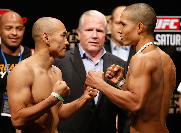 MACAU, MACAU - NOVEMBER 09:  (L-R) Opponents Tiequan Zhang and Jon Tuck face off during the UFC Macau weigh in at Cotai Arena on November 9, 2012 in Macau, Macau.  (Photo by Josh Hedges/Zuffa LLC/Zuffa LLC via Getty Images)