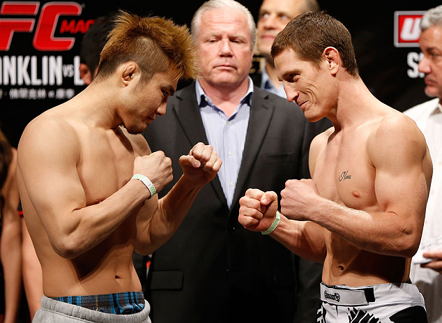 MACAU, MACAU - NOVEMBER 09:  (L-R) Opponents Takanori Gomi and Mac Danzig face off during the UFC Macau weigh in at Cotai Arena on November 9, 2012 in Macau, Macau.  (Photo by Josh Hedges/Zuffa LLC/Zuffa LLC via Getty Images)